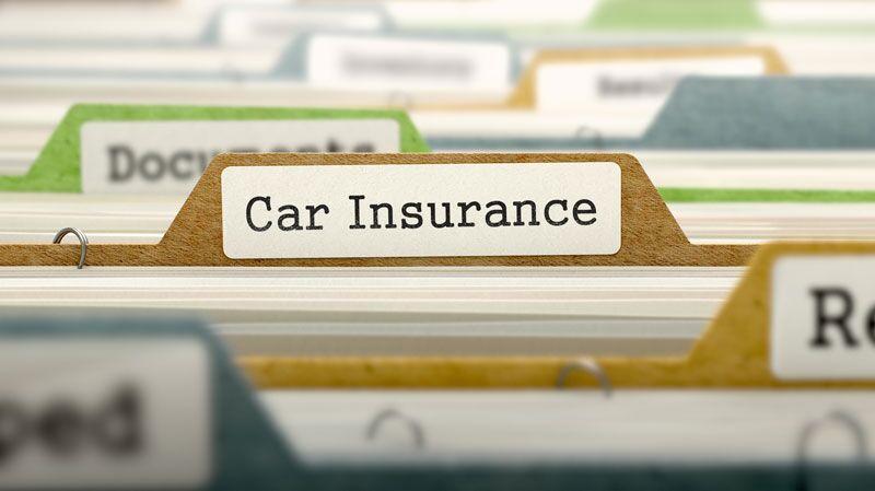 "manila file labeled ""car insurance"""