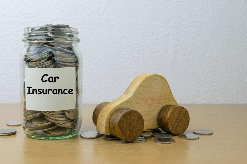 toy car next to jar of coins labelled car insurance, choosing the right amount of car coverage