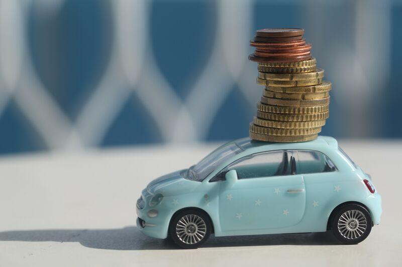 toy car with coins stacked on top, getting rid of your high-risk label